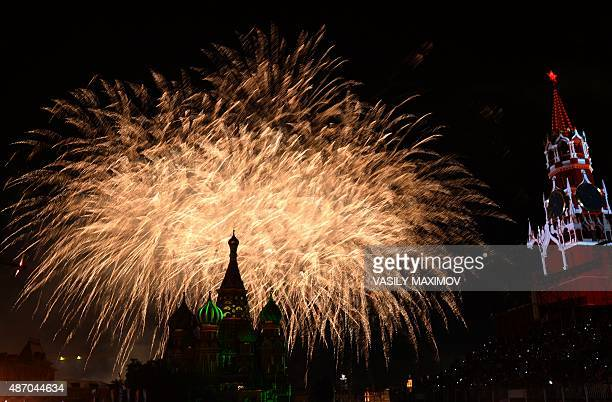 Fireworks explode above SaintBasil's cathedral during the Spasskaya Tower international military and music Festival on the Red Square in Moscow on...
