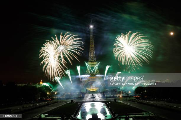 Fireworks explode above the Eiffel Tower and the Trocadero Gardens as part of the annual Bastille Day celebrations in Paris on July 14 2019