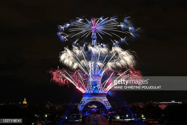 TOPSHOT Fireworks explode above the Eiffel Tower as part of the annual Bastille Day celebrations in Paris on July 14 2020 France is holding a reduced...