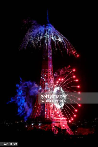 Fireworks explode above the Eiffel Tower as part of the annual Bastille Day celebrations in Paris on July 14 2020 France is holding a reduced version...