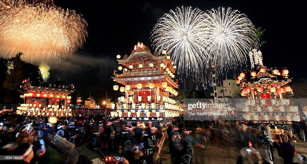Fireworks explode above the illuminated floats during the Chichibu Yomatsuri, or Chichibu Night Festival on December 3, 2013 in Chichibu, Saitama, Japan. 194,000 visitors enjoy the annual festival.