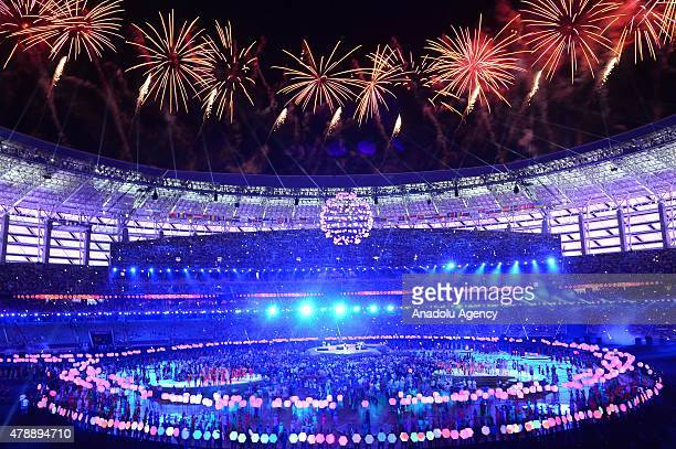 Fireworks explode above the stadium as dancers perform during the Closing Ceremony for the Baku 2015 European Games at Olympic Stadium on June 28...