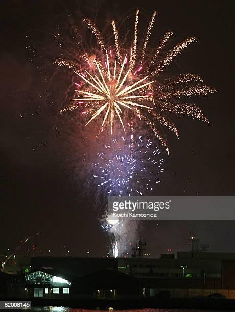 Fireworks explode after the Red Bull Flight Performance 2008 at Yokohama Minato Mirai Area on July 20 2008 in Yokohama Kanagawa Japan