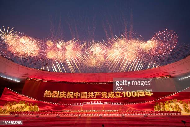Fireworks explode and dancers perform at the National Stadium during an art performance titled 'The Great Journey' in celebration of the 100th...