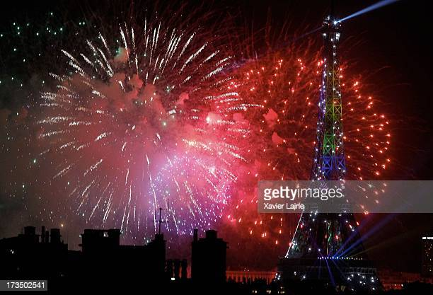 Fireworks explode around the Eiffel Tower during France's annual Bastille Day celebrations on July 14 2013 in Paris France