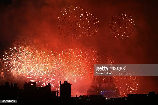 Fireworks explode around the Eiffel Tower during France's annual Bastille Day celebrations on July 14 2015 in Paris France
