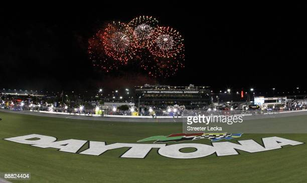 Fireworks explode around the speedway after the finish of the NASCAR Sprint Cup Series 51st Annual Coke Zero 400 at Daytona International Speedway on...