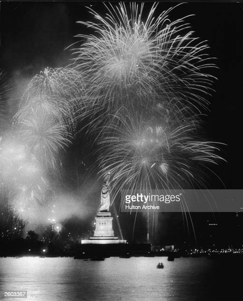 Fireworks explode around the Statue of Liberty duiring the American Bicentennial celebration New York City July 4 1976