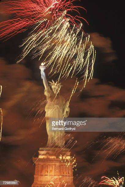 Fireworks explode around the Statue of Liberty during the American Bicentennial celebration New York City July 4 1976