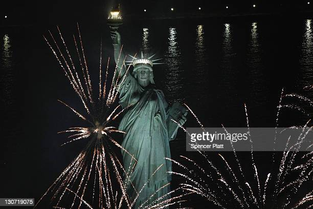 Fireworks explode around the Statue of Liberty in celebration of the anniversary of the dedication of the Statue of Liberty on October 28, 2011 in...