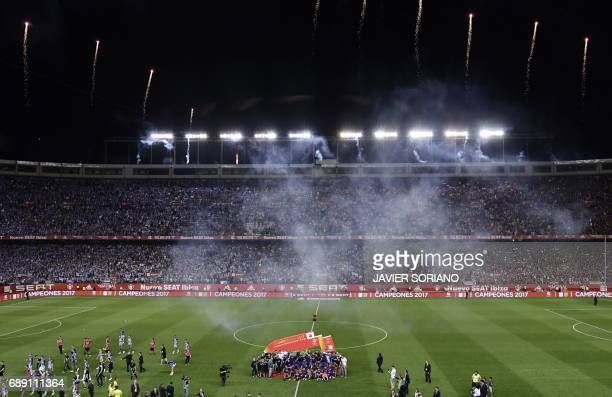 Fireworks explode as Barcelona players and staff pose with the trophy at the end of the Spanish Copa del Rey final football match FC Barcelona vs...