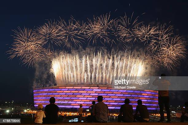 Fireworks explode as locals look on outside the Olympic Stadium during the Closing Ceremony for the Baku 2015 European Games at xxx on June 28, 2015...