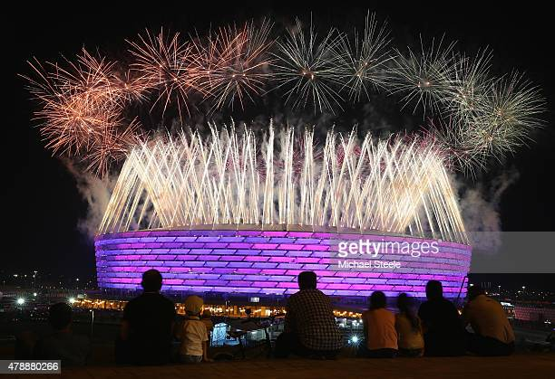 Fireworks explode as locals look on outside the Olympic Stadium during the Closing Ceremony for the Baku 2015 European Games at xxx on June 28 2015...