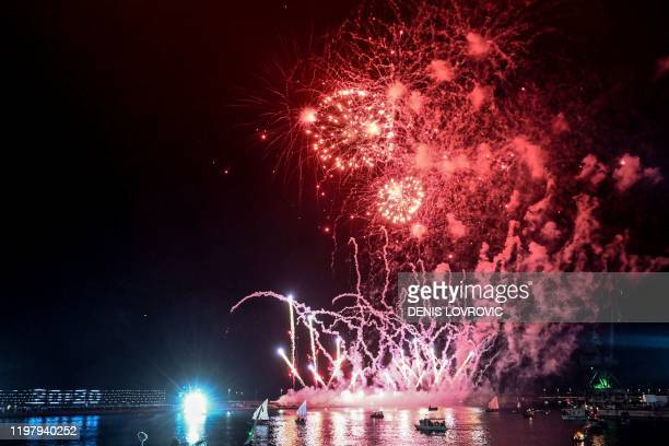 Fireworks explode as Old traditional boats sail in the port of Rijeka on February 1, 2020 during an open-air ceremony dubbed 'Opera Industriale' as...