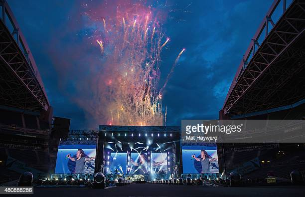Fireworks explode as One Direction walks out on stage at CenturyLink Field on July 15 2015 in Seattle Washington