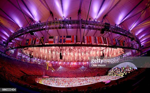 Fireworks explode as performers dance during the Opening Ceremony of the Rio 2016 Olympic Games at Maracana Stadium on August 5, 2016 in Rio de...