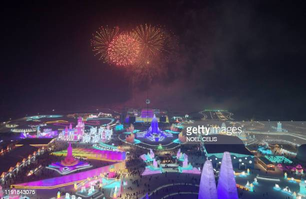Fireworks explode at the Harbin International Ice and Snow Festival in Harbin in China's northeast Heilongjiang province on January 5 2020
