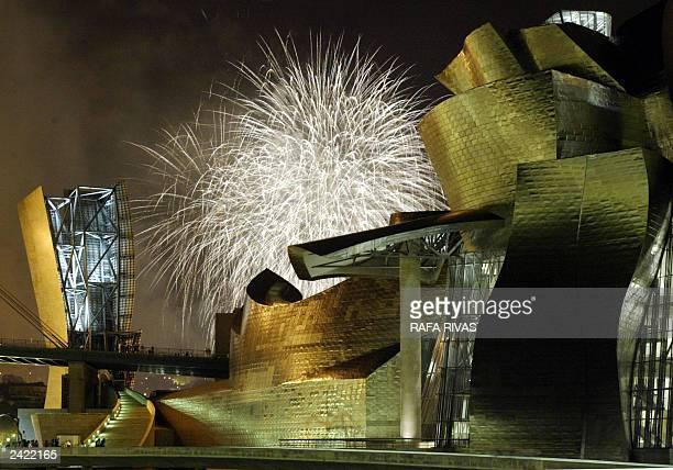 "Fireworks explode behind the Guggenheim Bilbao Museum late 22 August 2003, during the Bilbao local fair ""Aste Nagusia"" fireworks international..."