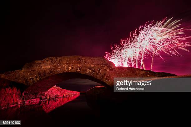 Fireworks explode behind the Swilken Bridge as part of the Dunhill Links celebrations at The Old Course on October 07 2017 in St Andrews Scotland