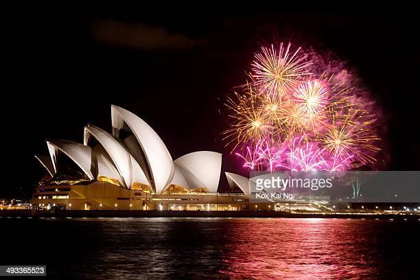Fireworks explode behind the Sydney Opera House.