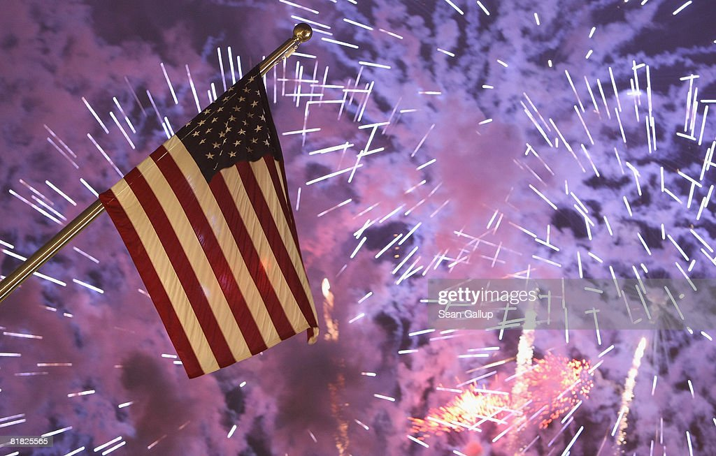 Fireworks explode behind the U.S. flag hanging from the front facade of the new U.S. embassy at the official opening ceremony and celebration of the embassy on July 4, 2008 in Berlin, Germany. Architectural critics claim the embassy, designed by American architect Moore Ruble Yudell, offers little in architectural innovation or design.