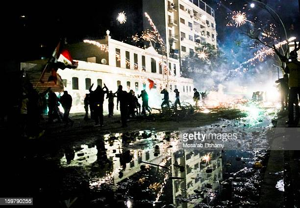 Fireworks explode during intense clashes between riot police and protesters near Tahrir square. The clashes broke out shortly after the Port Said...