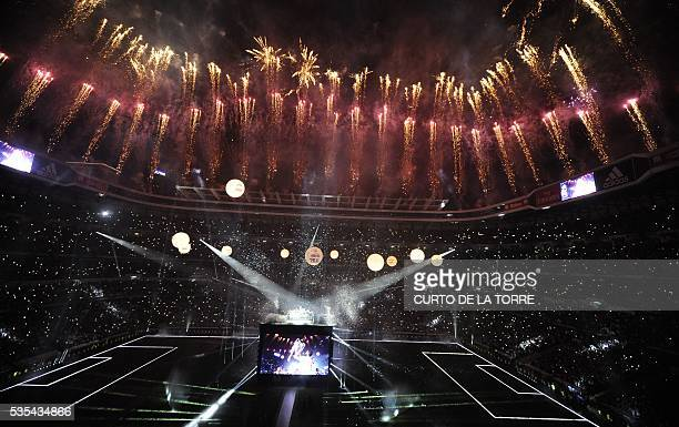 Fireworks explode during Real Madrid celebrations for their 11th UEFA Champions Cup at the Santiago Bernabeu stadium in Madrid on May 29 a day after...