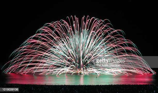 Fireworks explode during the Kumano Fireworks Festival on August 17 2018 in Kumano Mie Japan