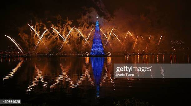 Fireworks explode during the lighting ceremony for Rio de Janeiro's famed floating Christmas tree in Lagoa Rodrigo de Freitas on November 30 2013 in...