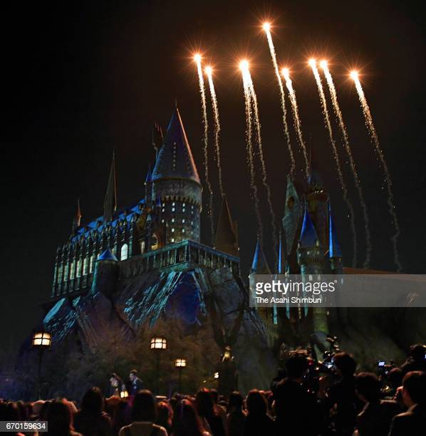 Fireworks explode during the new night show of the Harry Potter area during the press preview at the Universal Studios Japan on April 18 2017 in...