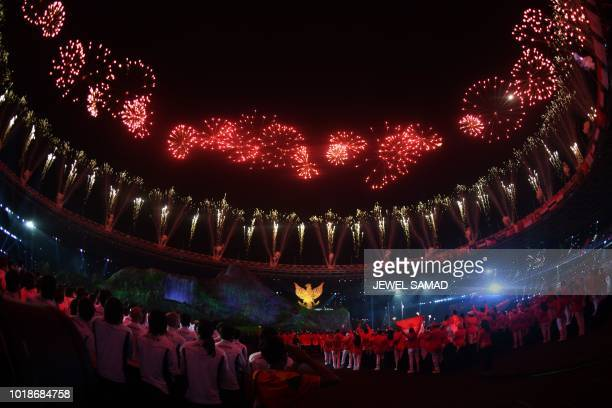 TOPSHOT Fireworks explode during the opening ceremony of the 2018 Asian Games at the Gelora Bung Karno main stadium in Jakarta on August 18 2018