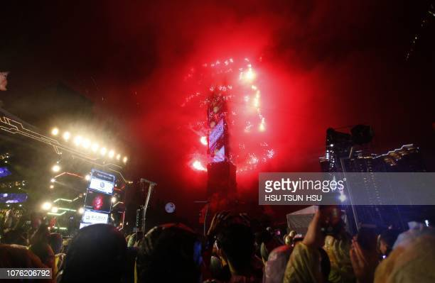 Fireworks explode from Taipei 101 building during Taipei New Year's Eve countdown party in Taipei Taiwan on January 1 2019