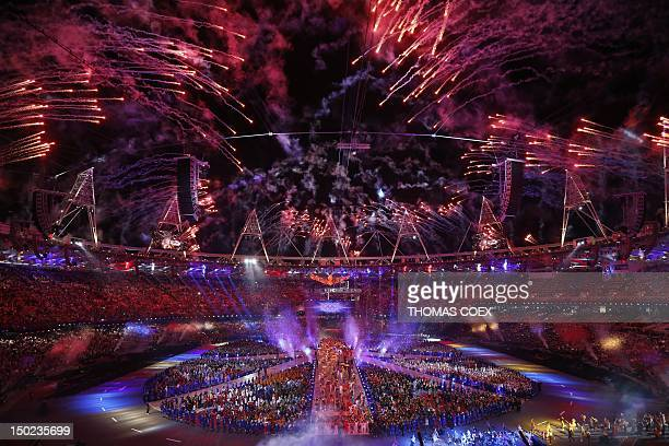 Fireworks explode from the periphery of the Olympic stadium during the closing ceremony of the 2012 London Olympic Games in London on August 12,...