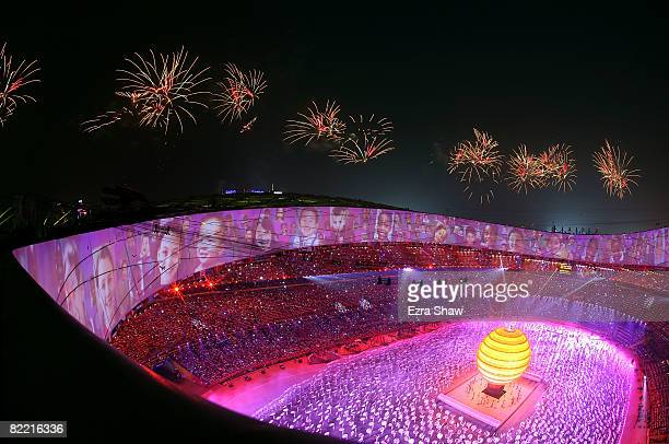 Fireworks explode from the stadium roof during the Opening Ceremony for the 2008 Beijing Summer Olympics at the National Stadium on August 8 2008 in...