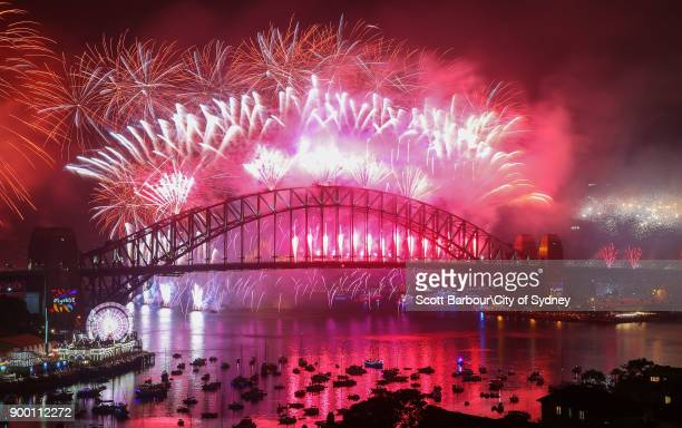 Fireworks explode from the Sydney Harbour Bridge and the Sydney Opera House during the midnight fireworks display on New Year's Eve on New Year's Eve...