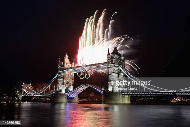 Fireworks explode from Tower Bridge during the opening ceremony of the London 2012 Olympic Games on July 27, 2012 in London, England.