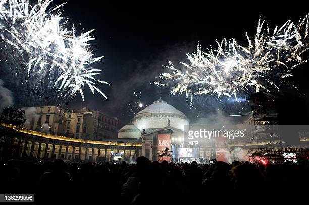 Fireworks explode in Plebiscito square in downtown Naples during the celebrations for new year's eve on January 1 2012 AFP PHOTO / ANNA MONACO
