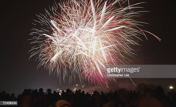 Fireworks explode in the night sky as people gather to celebrate Guy Fawkes Night on Blackheath Common on November 4 2006 in London England