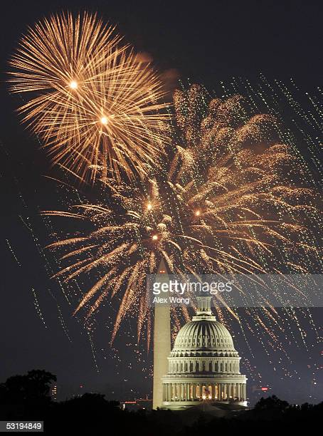 Fireworks explode in the sky above the Washington Monument as the US Capitol is seen in the foreground while the nation celebrates its 229th birthday...