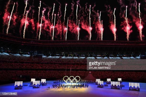 Fireworks explode in the sky during opening ceremony of the Tokyo 2020 Olympic Games, at the Olympic Stadium in Tokyo, on July 23, 2021.