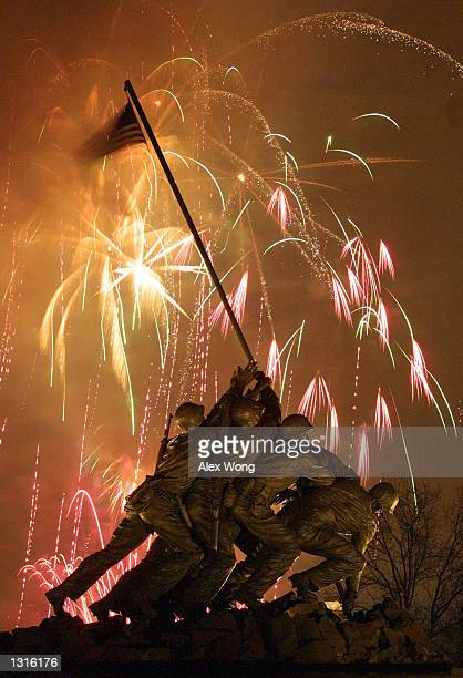 Fireworks explode January 18 2001 over the Iwo Jima Memorial in Arlington VA during the Presidential Inaugural Opening Celebration that is held at...