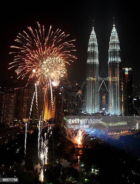 Fireworks explode near Malaysia's landmark Patronas Twin Towers during the New Year 2010 celebrations in Kuala Lumpur on January 1 2010 AFP PHOTO/...
