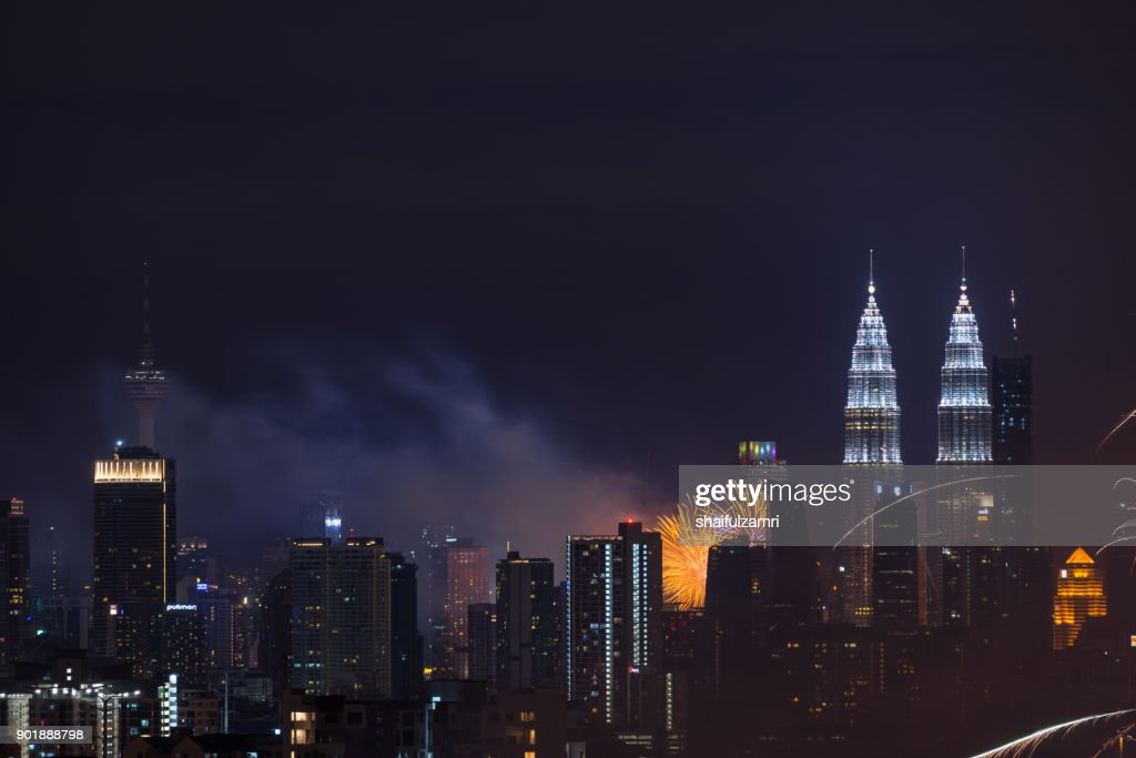 Fireworks explode near Malaysia's landmark Petronas Twin Towers during New Year celebrations in Kuala Lumpur : Stock Photo