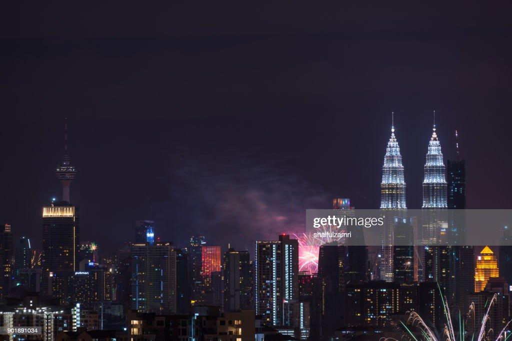 Fireworks explode near Malaysia's landmark Petronas Twin Towers during New Year celebrations in Kuala Lumpur : Stock Photo