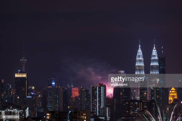 fireworks explode near malaysia's landmark petronas twin towers during new year celebrations in kuala lumpur - shaifulzamri stock pictures, royalty-free photos & images