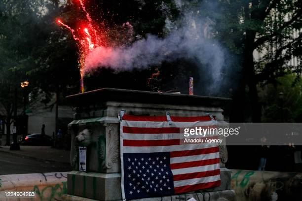 Fireworks explode near the Justice Center as Black Lives Matter supporters demonstrate in Portland, Oregon on July 4, 2020 for the thirty-eighth day...