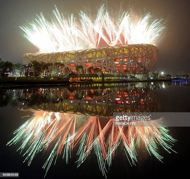 """Fireworks explode next to the National Stadium, also known as the """"Bird's Nest"""", during the opening ceremony of the 2008 Beijing Olympic Games on..."""