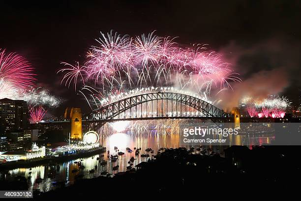 Fireworks explode off the Sydney Harbour Bridge during the midnight fireworks display on New Year's Eve on Sydney Harbour on December 31 2014 in...