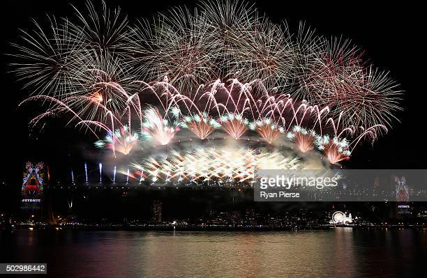 Fireworks explode off the Sydney Harbour Bridge during the midnight fireworks display on New Year's Eve on Sydney Harbour on January 1 2016 in Sydney...