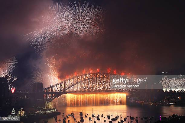 Fireworks explode off the Sydney Harbour Bridge on New Year's Eve on January 1 2017 in Sydney Australia